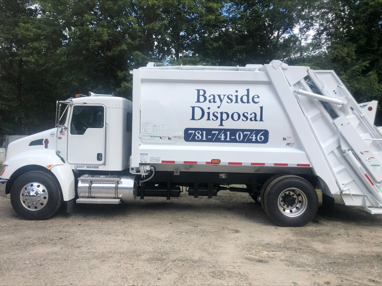 hull ma trash and recycling service truck white with blue lettering and phone number